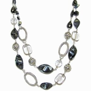 layered necklace with silver beads and dark gems