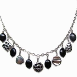 necklace with rows of metallic beads and dark crystals