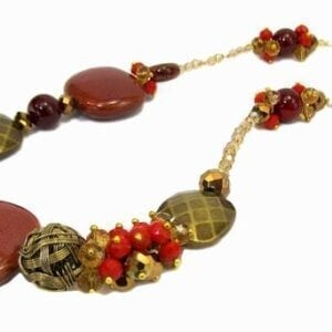 necklace with red, brown, and orange beads of various sizes