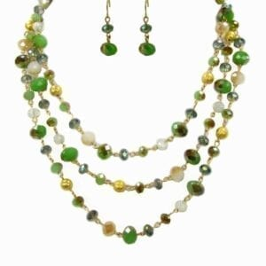 earrings and layered necklace with green and yellow gems