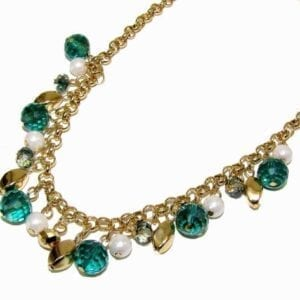 gold necklace with blue gem and golden pebble attachments