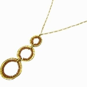 necklace pendant with a column of three golden hoops