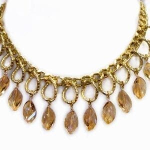 golden necklace with gold chain and light brown hanging gems