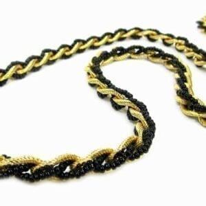 twisted necklace with gold chain and black pearls