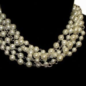pearl necklace with silver chains on a mannequin