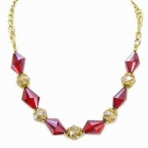 gold necklace with red gemstones and crystal beads