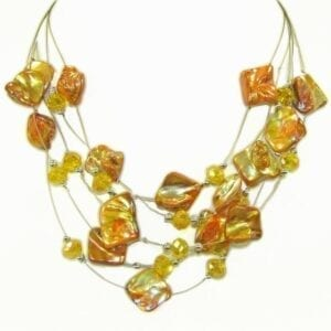 layered necklace with bunch of yellow stones and crystals