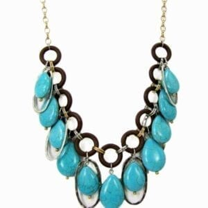 necklace with large circular blue gemstones, black hoops, and silver chain