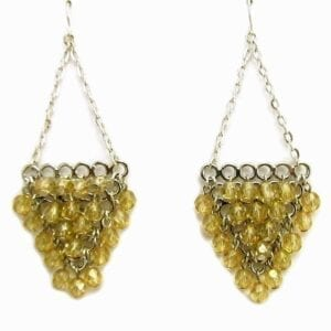 earrings with yellow gems arranged in an upside-down triangle