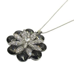 floral necklace with black gems and white crystals