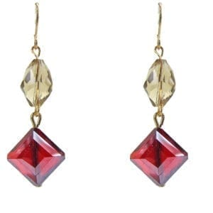 earrings with pale yellow and red gemstones