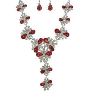 silver necklace and earrings with teardrop rubies and diamond starbursts
