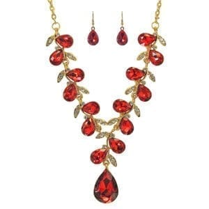 gold necklace with teardrop ruby gems arranged like a vine