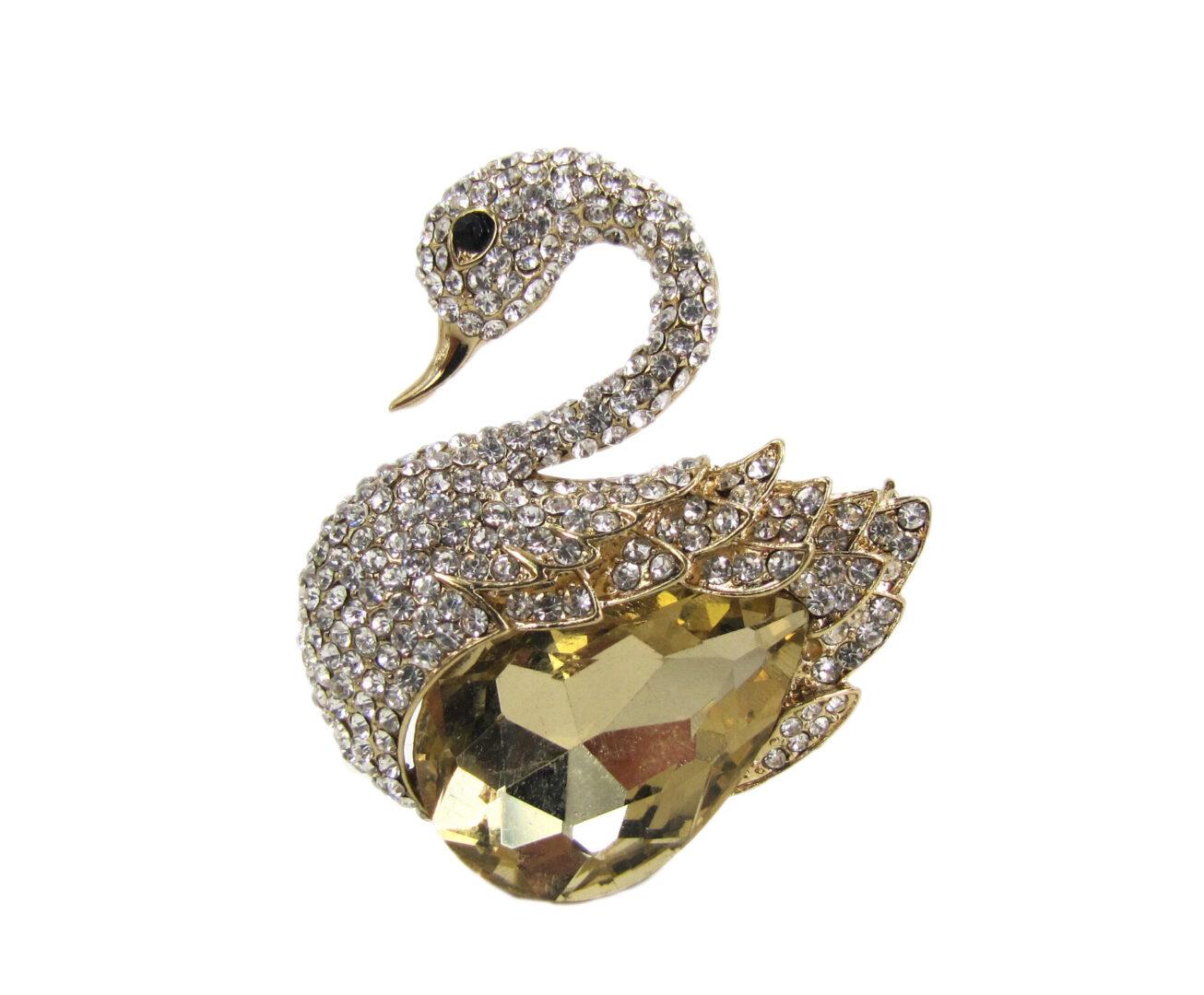 swan brooch with large brown topaz crystal
