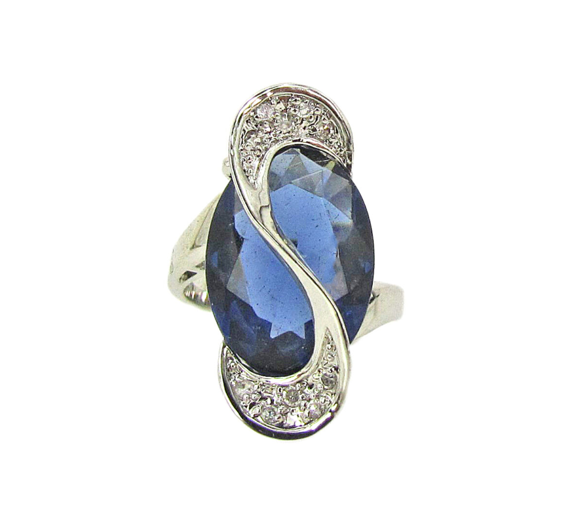ring with s-shaped accent and a sapphire gem