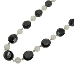 segment of a necklace with white and black gemstones