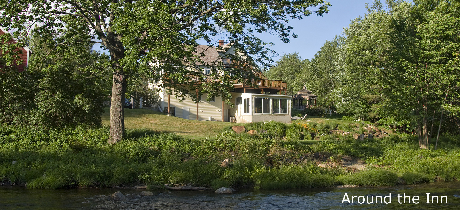 View of Inn at Ellis River across the river