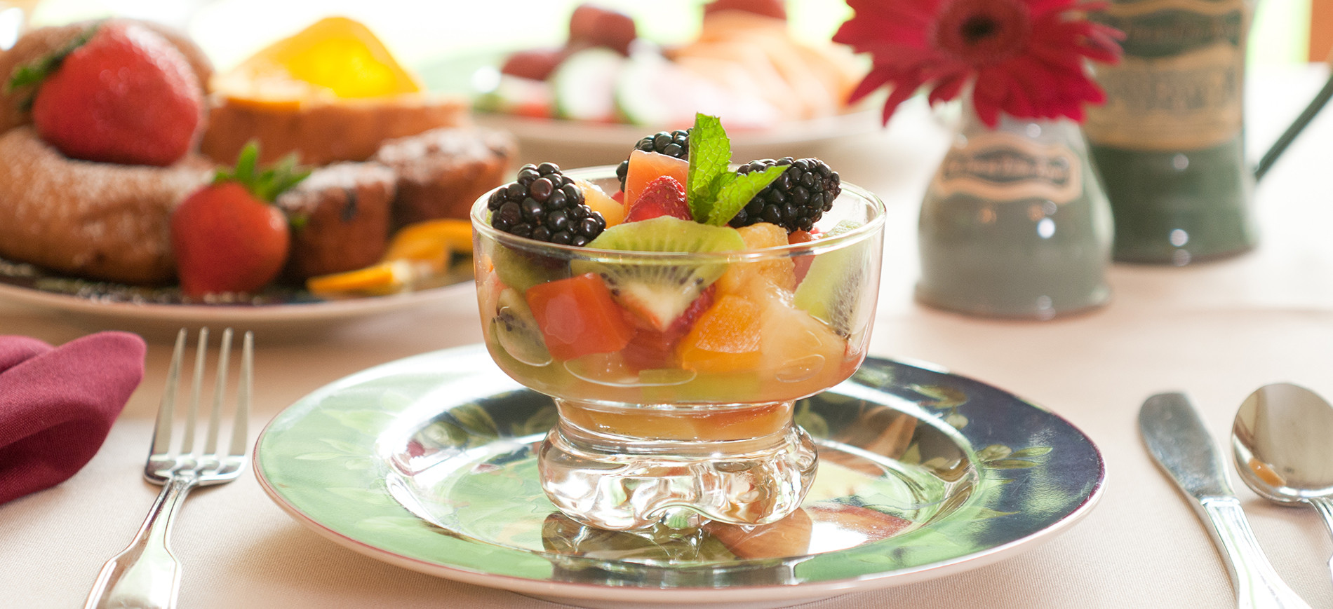 Fruit cup in glass bowl on plate