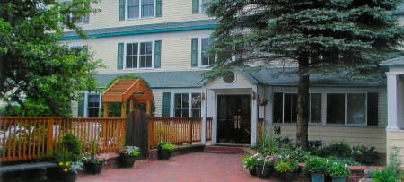 Inn at Ellis River entrance with flower pots