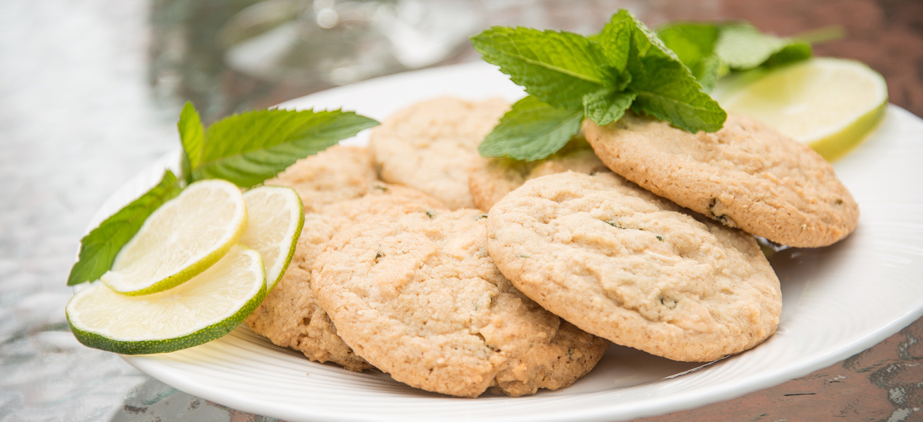 Mojitoo Cookies on white plate with mint & lime slice garnish