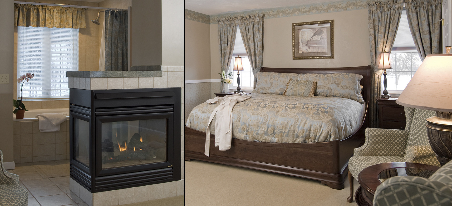 wing chair, jetted tub tub with window above behind three sided gas fireplace, king bed with blue & beige bedding,windows with drapes & nightstand with lamp on each side of bed
