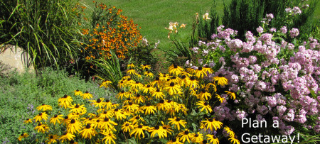 Perennial flower garden in bloom ~ Plan Your Getaway