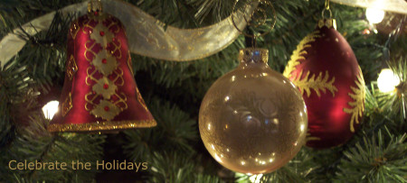 Celebrate the Holidays! Red & gold bell, gold ball, red & gold ball & gold ribbon on Christmas tree