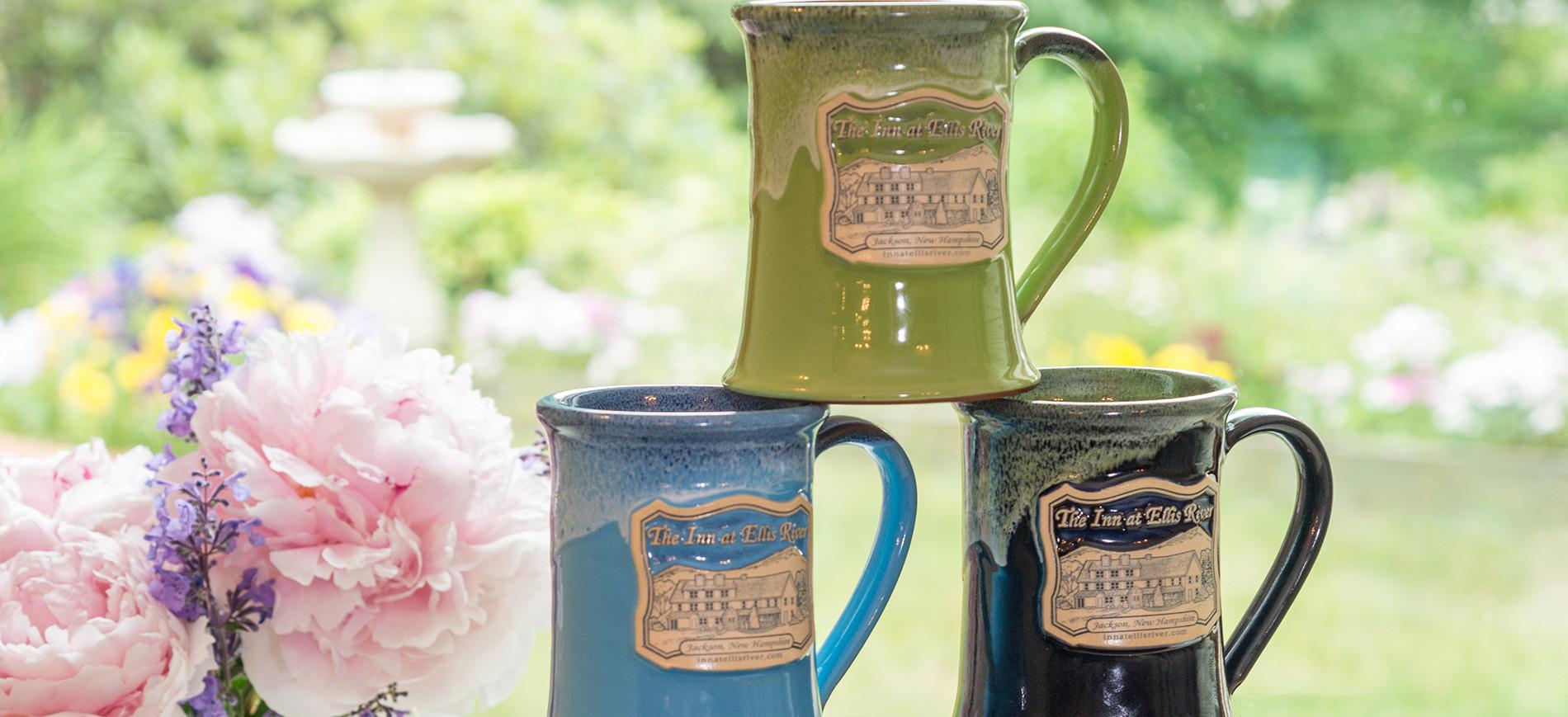 Peonies to left of three coffee mugs