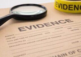 magnifying glass and evidence bag for crime scene investigation