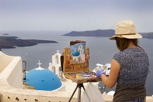 Painting in Santorini • Photo by Celia Carson