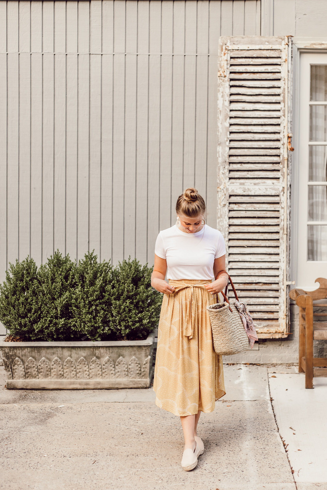 Step Out of Your Color Comfort Zone   Casual Summer Style   Basic White Tee and Yellow Midi Skirt styled on Louella Reese