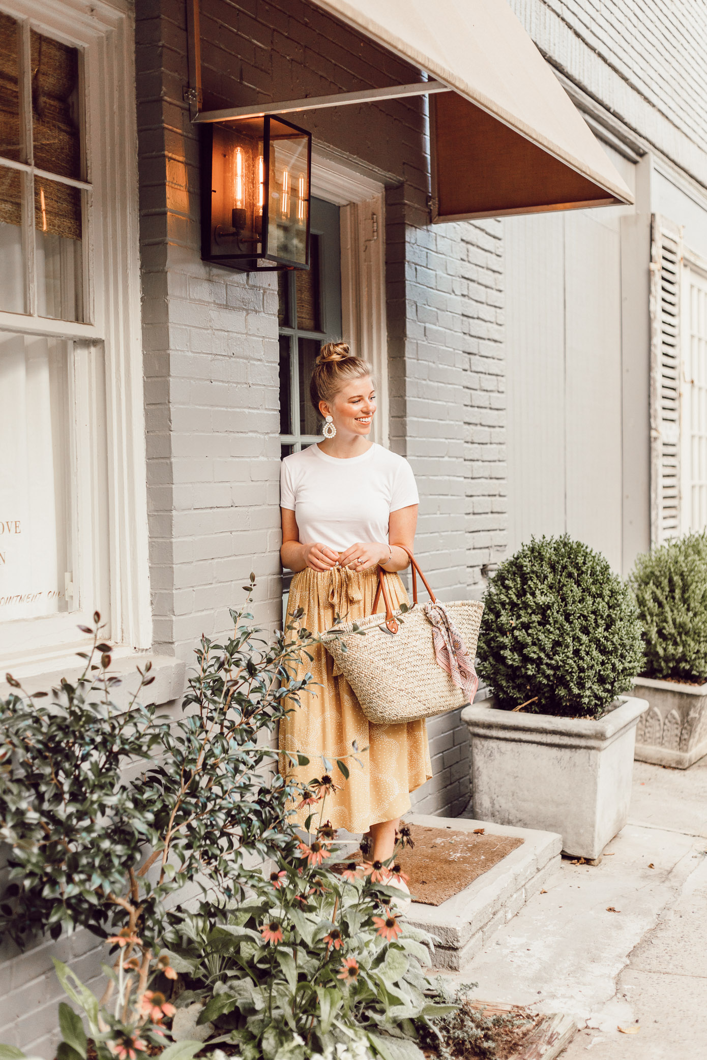 Step Out of Your Color Comfort Zone   Yellow Midi Skirt, Straw Basket Bag styled on Louella Reese