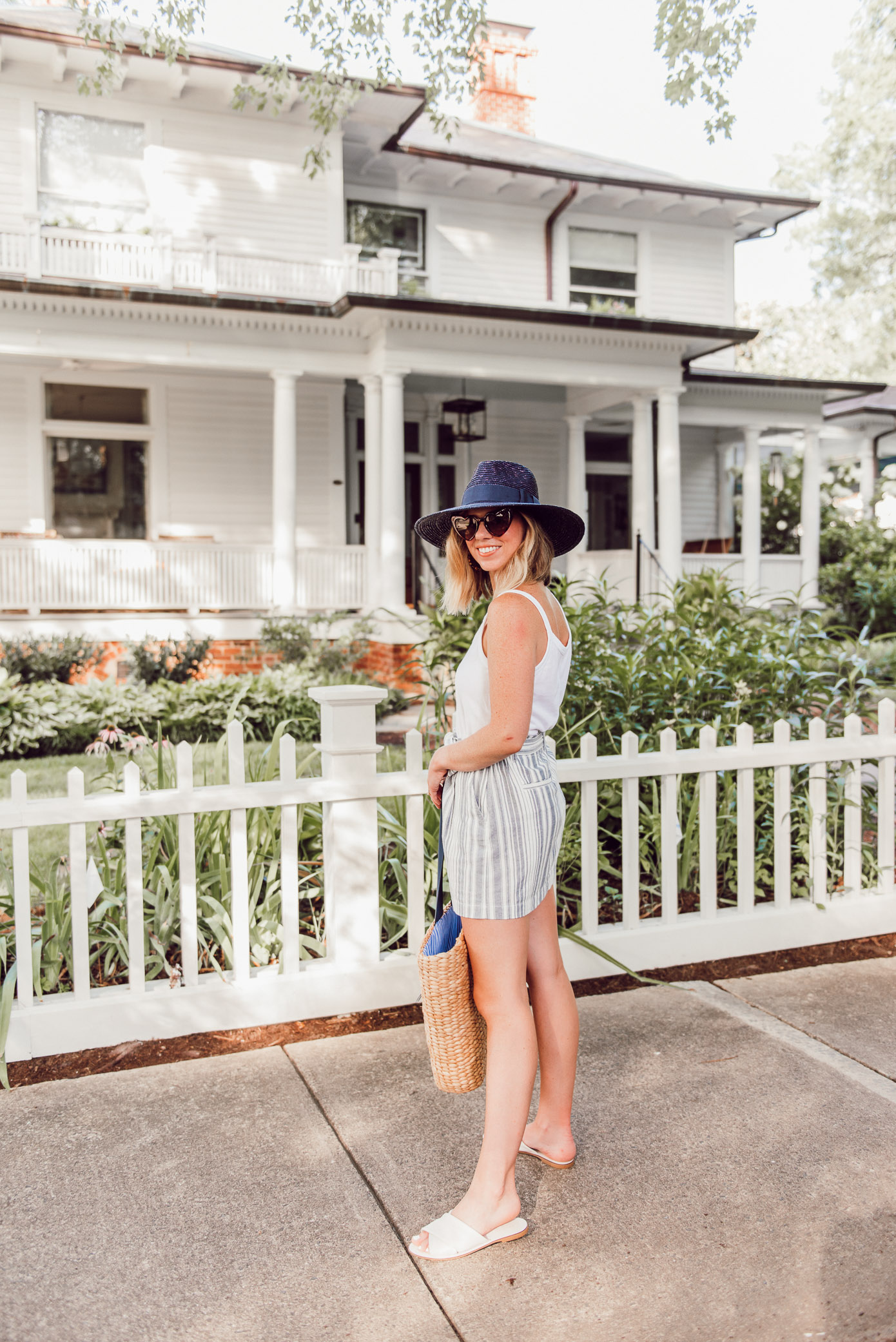 Casual Summer Outfit Idea   Cotton Cami, Linen Striped Skirt, Navy Straw Hat under $50   Louella Reese
