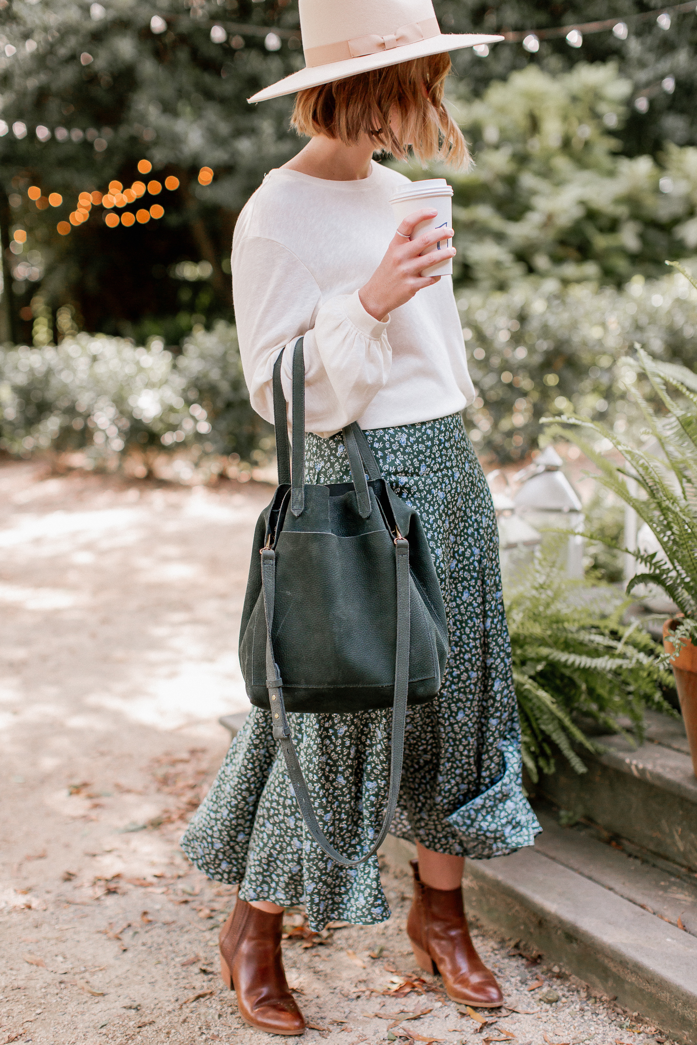 Fall Outfit Idea | Long Sleeve T-Shirt, Floral Midi Skirt, Brown Leather Booties, Green Suede Tote | Louella Reese