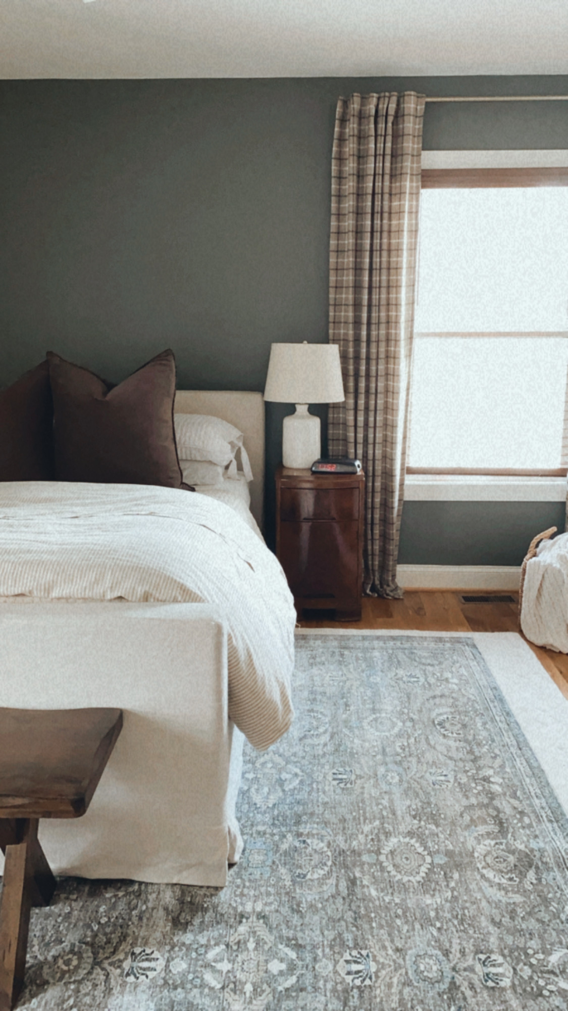 Neutral Master Bedroom with Green Accent Wall | Louella Reese