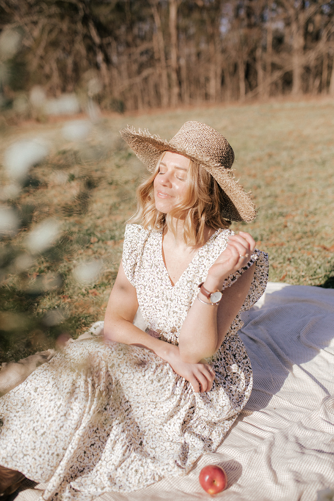 feminine spring outfit, lack of color straw hat | Louella Reese