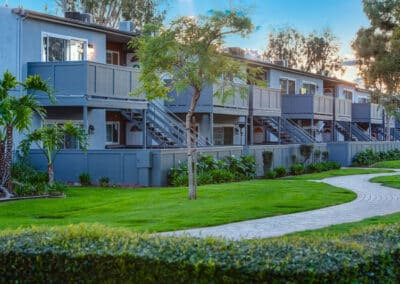 Countrywood Apartment Homes complex walkways with grass and trees