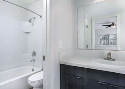Bathroom showing a white sink, toilet and bathtub