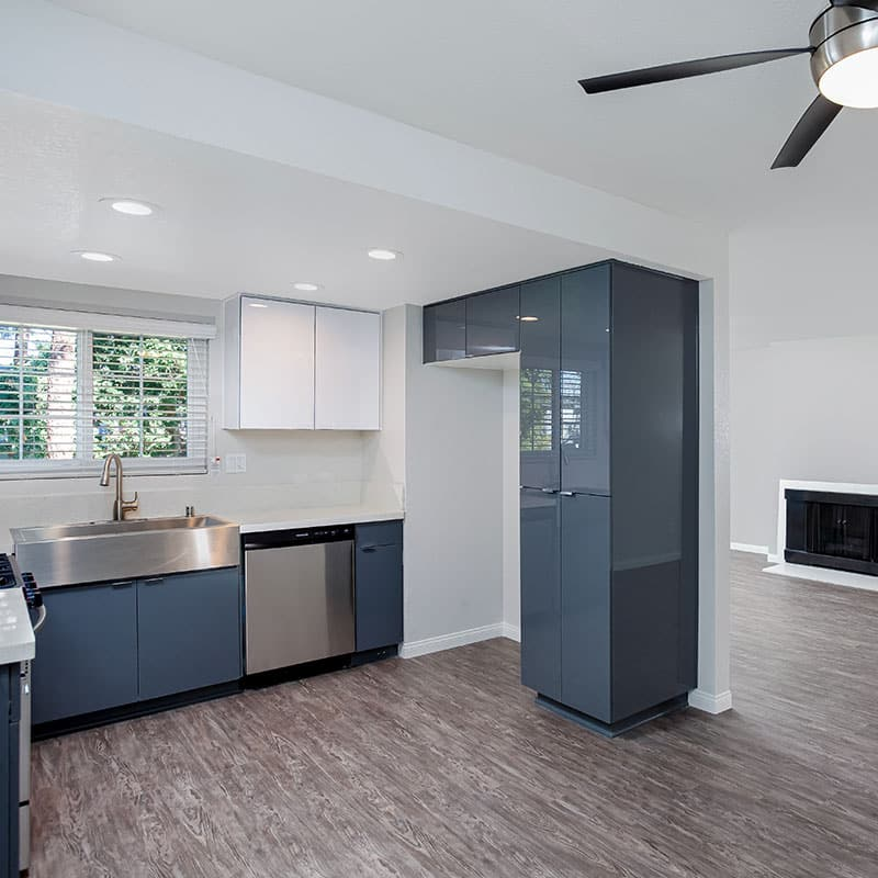 Kitchen showing Stainless Steel Sink, window, and cabinets