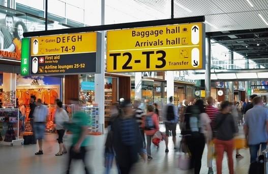 People Walking in Airport Terminal