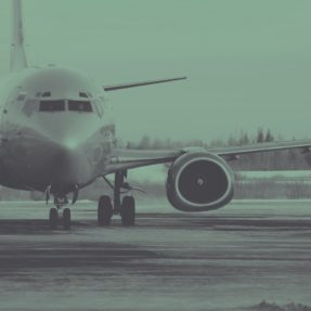 Gray Airplane on Tarmac