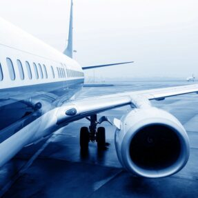 View of side of a plane looking at the engine and wing