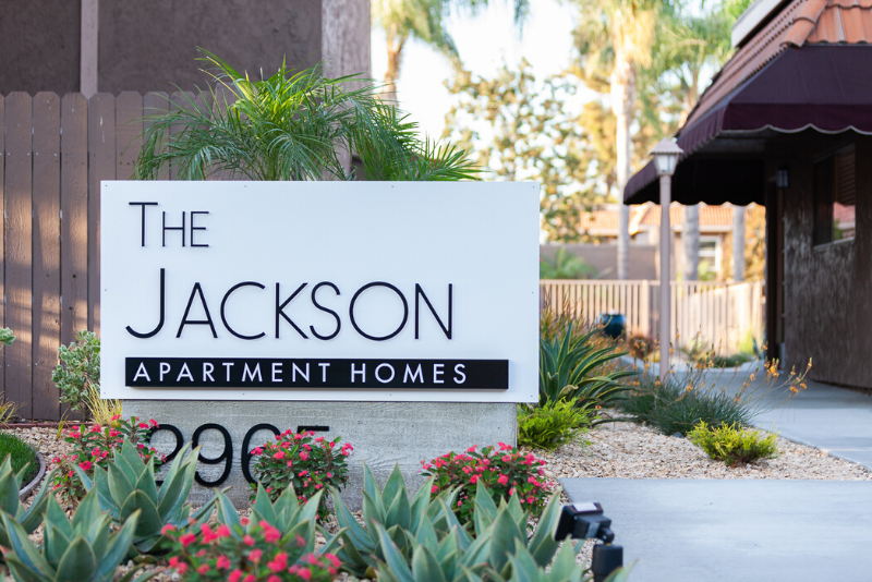 The Jackson Apartment Homes Sign with landscaping