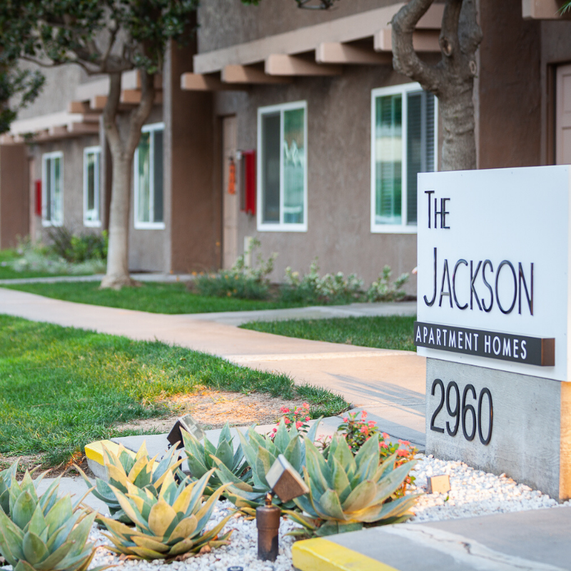 The Jackson Sign with grass and pathways