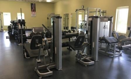 South West gym corner with weight resistance machines.