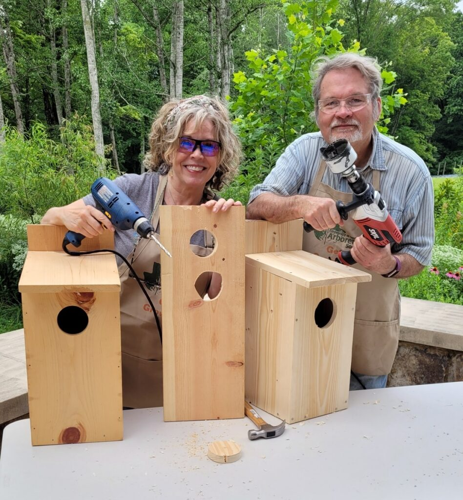 MIchelle Campanis and Stephen Lyn Bales with screech-owl boxes
