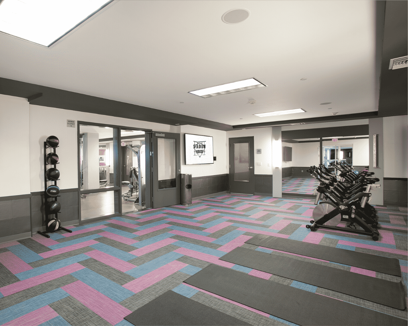 Fitness center with mats and weights