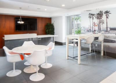 Co-working spaces with chairs and tables and tvs