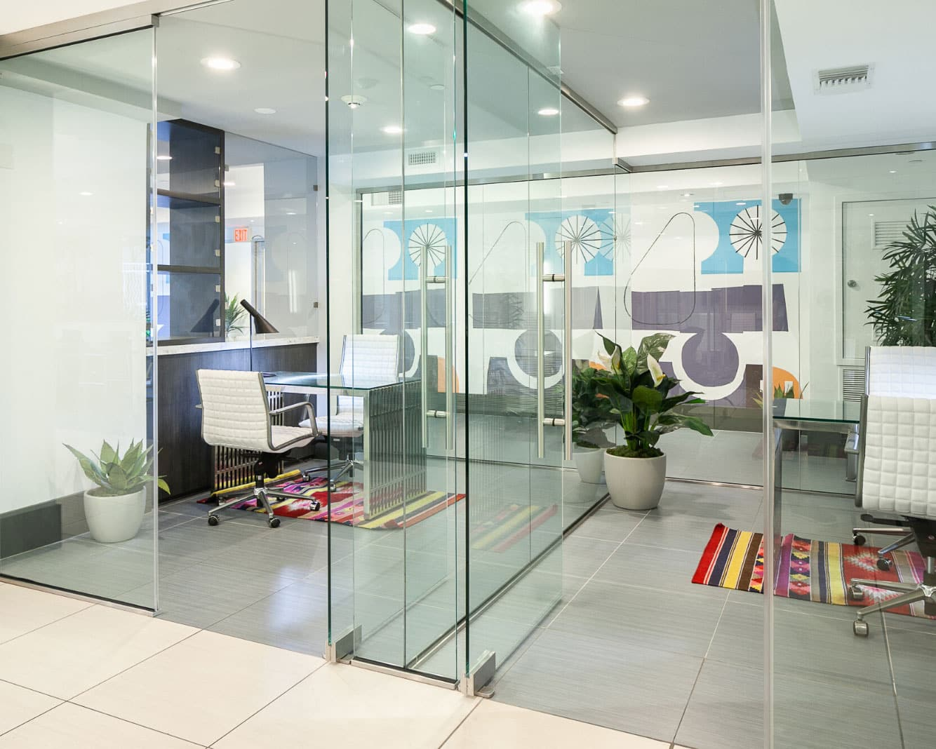 mini conference rooms with glass walls and tables and chairs