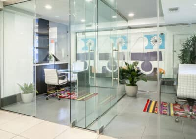 mini conference rooms with glass walls and furniture